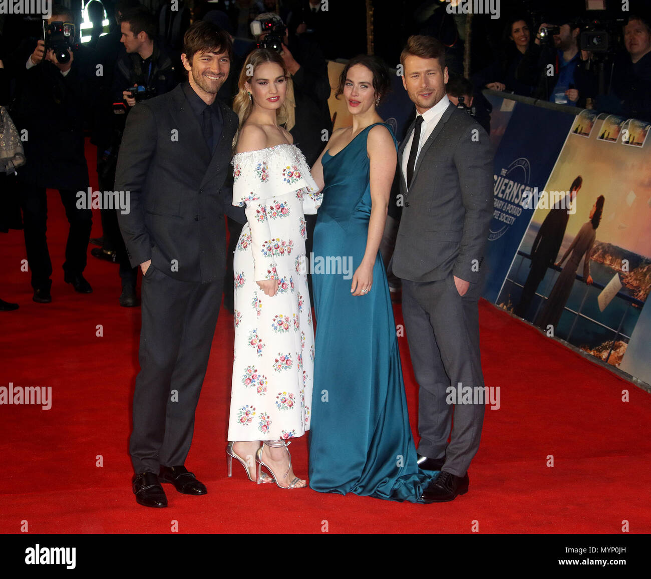 April 9, 2018 - Michiel Huisman, Lily James, Jessica Brown Findlay and Glen Powell attending The Guernsey Literary and Potato Peel Pie Society World P - Stock Image