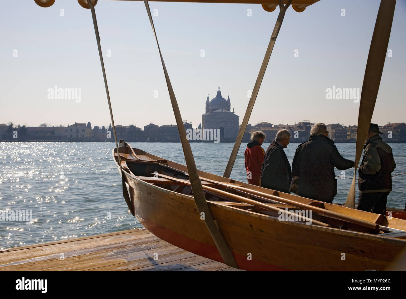Bucintoro Rowing Club, Dorsoduro, Venice Italy: a 'topo' in slings ready for racing, and in the background, the Canal della Guidecca - Stock Image