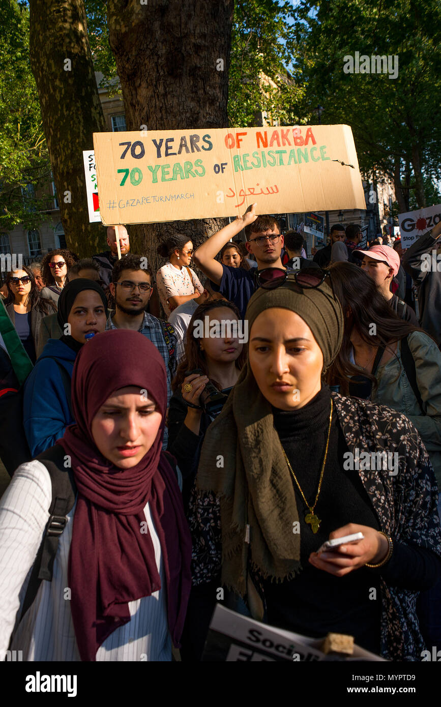 Protesters with placards at the Gaza: Stop The Massacre rally in Whitehall, London, in protest of Palestinian civilians killed by Israeli military. - Stock Image
