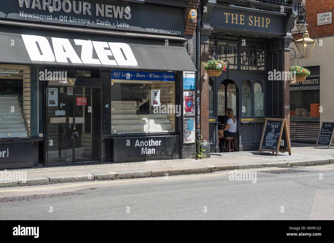Wardour News newsagent shop and The Ship public house, Wardour Street, Soho, London, England, UK. - Stock Image