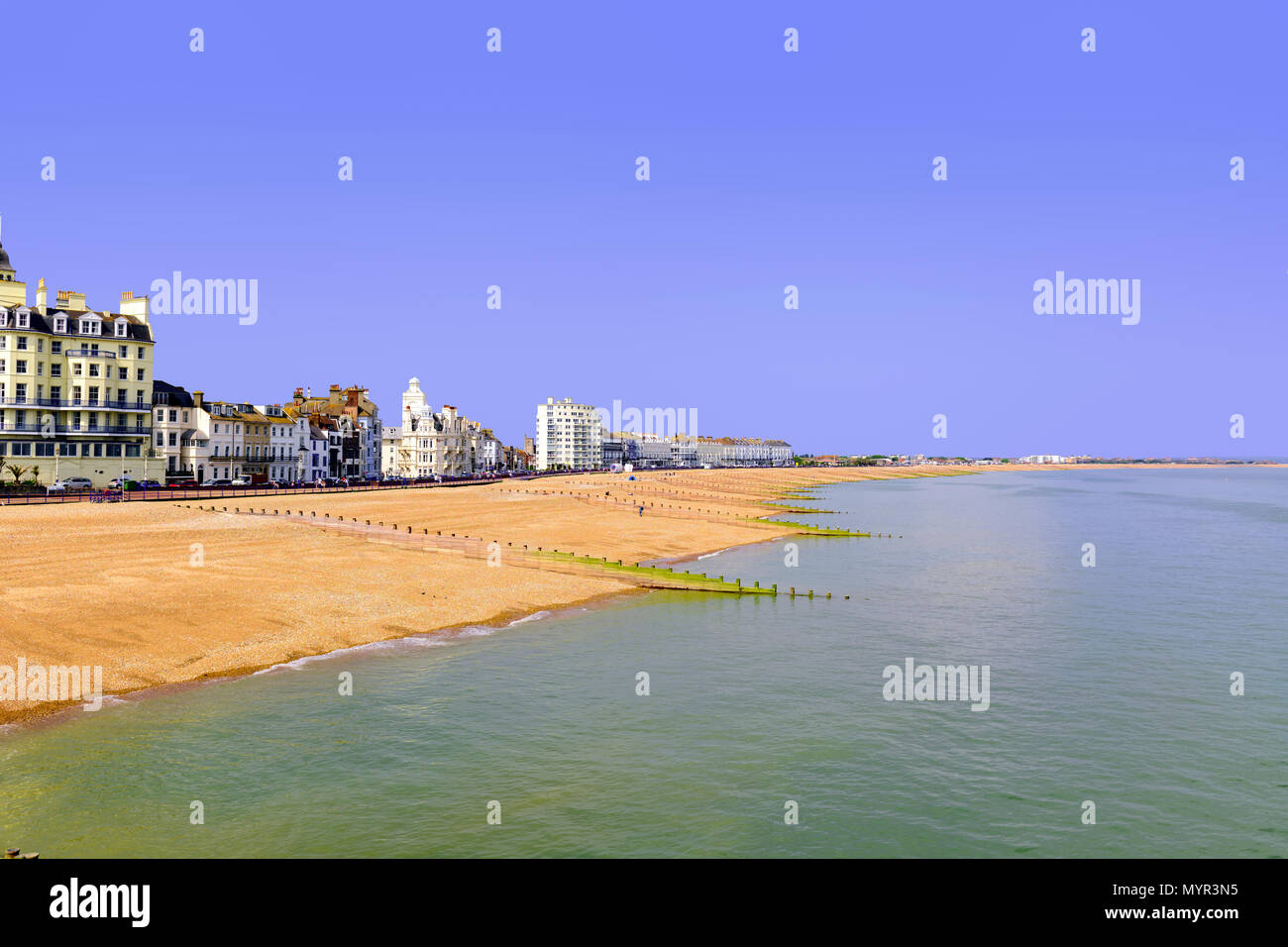 View of Eastbourne beach from the pier - Stock Image