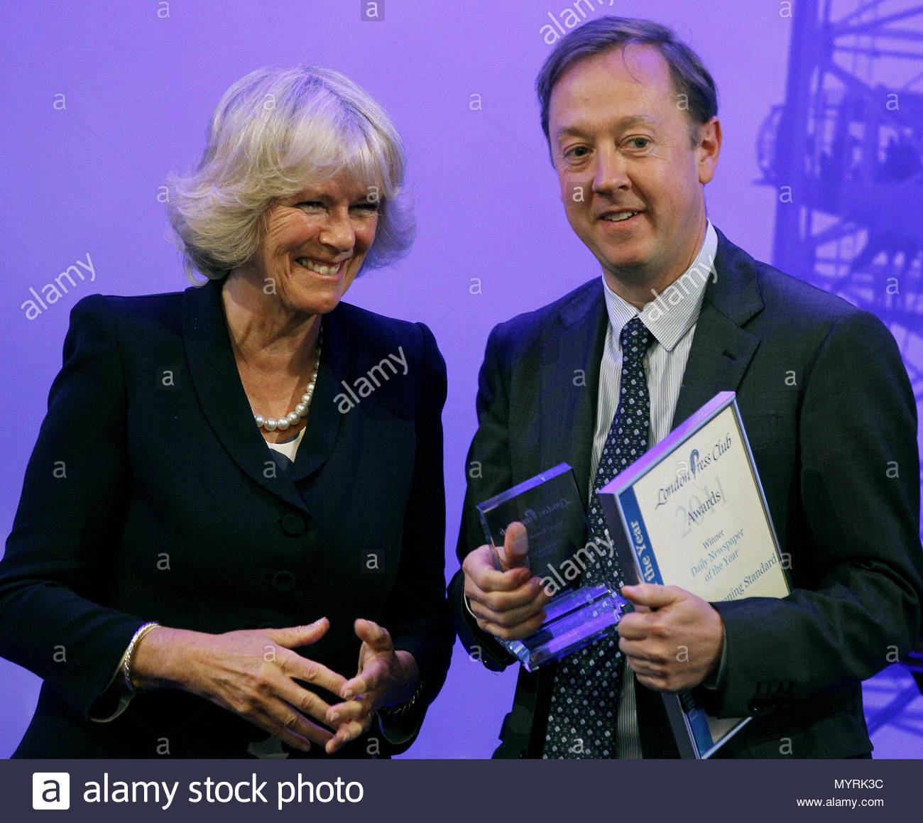 File photo dated 11/5/2011 of the Duchess of Cornwall presenting Geordie Greig, Editor of the London Evening Standard with the Daily Newspaper of the Year Award at the London Press Club Awards in London. Greig's appointment as Daily Mail editor follows the announcement on Wednesday that Paul Dacre is to become chairman and editor in chief of Associated Newspapers. - Stock Image