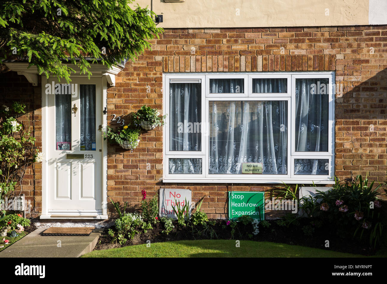 Sipson, UK. 5th June, 2018. Signs calling for no third runway at Heathrow airport inside and outside a house in Sipson. - Stock Image
