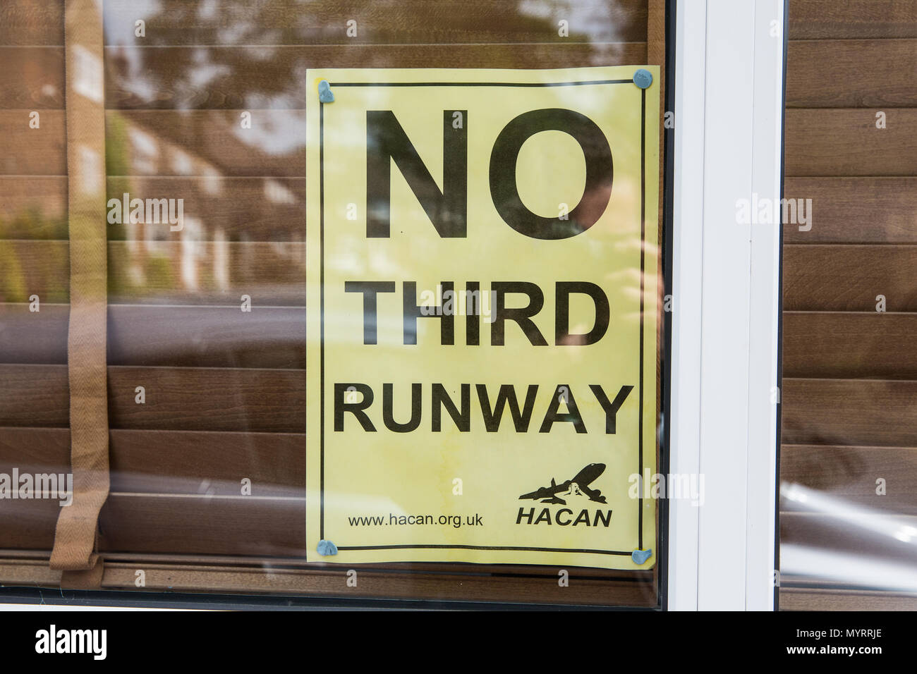 Harmondsworth, UK. 5th June, 2018. A 'No Third Runway' poster in the window of a house in Harmondsworth village. - Stock Image