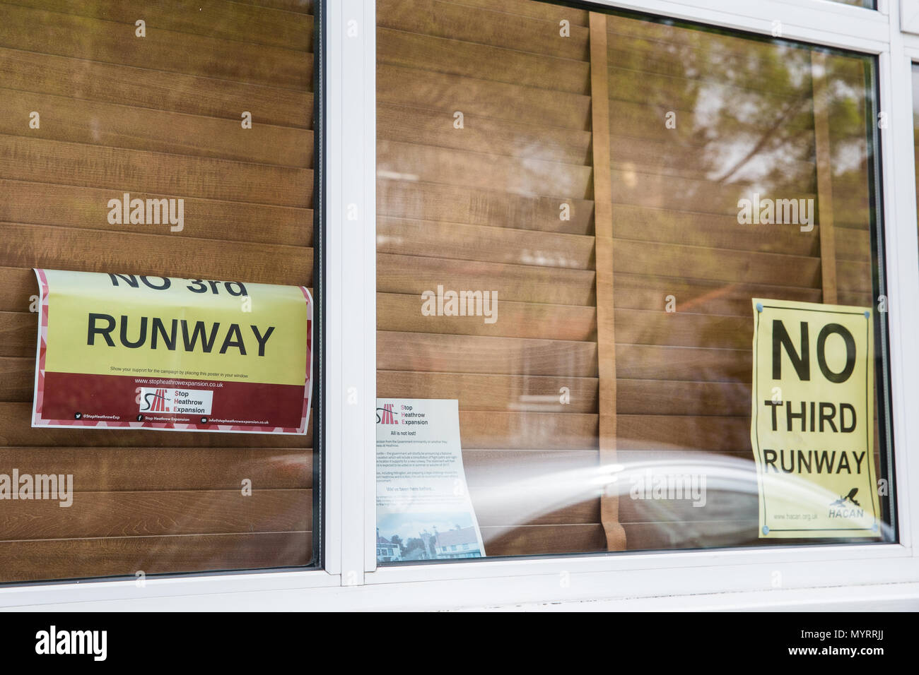Harmondsworth, UK. 5th June, 2018. 'No Third Runway' posters in the window of a house in Harmondsworth village. - Stock Image
