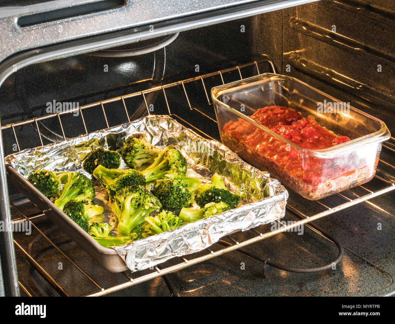 prepared meals dream dinners meatloaf milano with oven roasted broccoli in oven Stock Photo