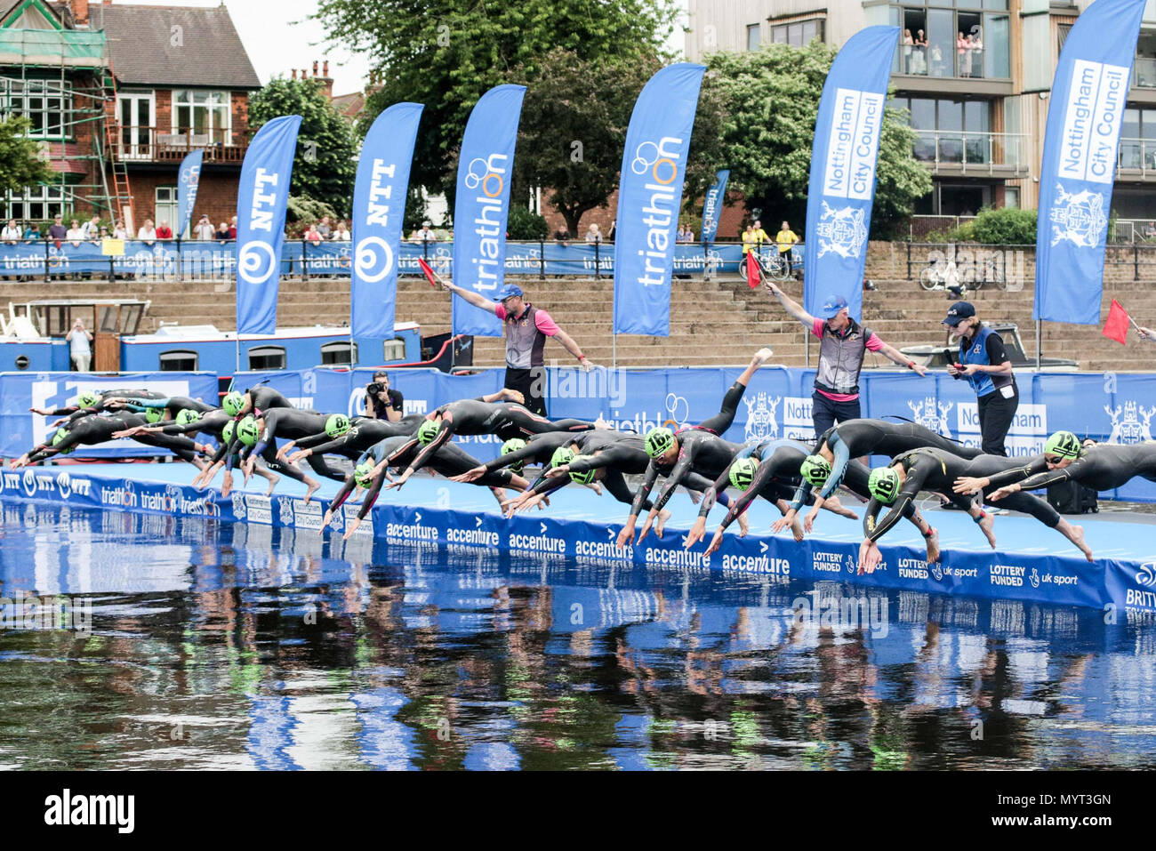 Nottingham, UK. 7th Jun, 2018. Swimmers enter the water from the pontoon to start the Mixed Relay Triathlon   Credit: Dan Cooke Credit: Dan Cooke/Alamy Live News - Stock Image