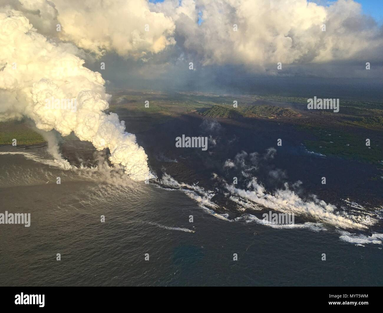 Hawaii, USA. 6th June, 2018. Lava flows into Kapoho Bay destroying forest and homes in the Vacationland area caused by the eruption of the Kilauea volcano June 6, 2018 in Hawaii. The recent eruption continues destroying homes, forcing evacuations and spewing lava and poison gas on the Big Island of Hawaii. Credit: Planetpix/Alamy Live News Stock Photo