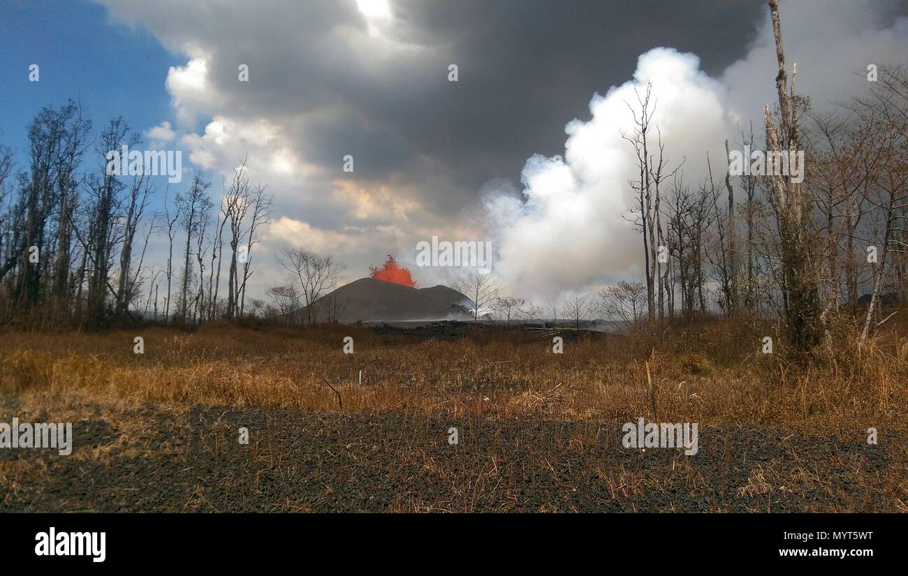 Hawaii, USA. 6th June, 2018. A massive lava fountain spewing magma 150 feet into the air from fissure 8 at the corner of Nohea and Leilani caused by the eruption of the Kilauea volcano June 6, 2018 in Hawaii. The recent eruption continues destroying homes, forcing evacuations and spewing lava and poison gas on the Big Island of Hawaii. Credit: Planetpix/Alamy Live News - Stock Image