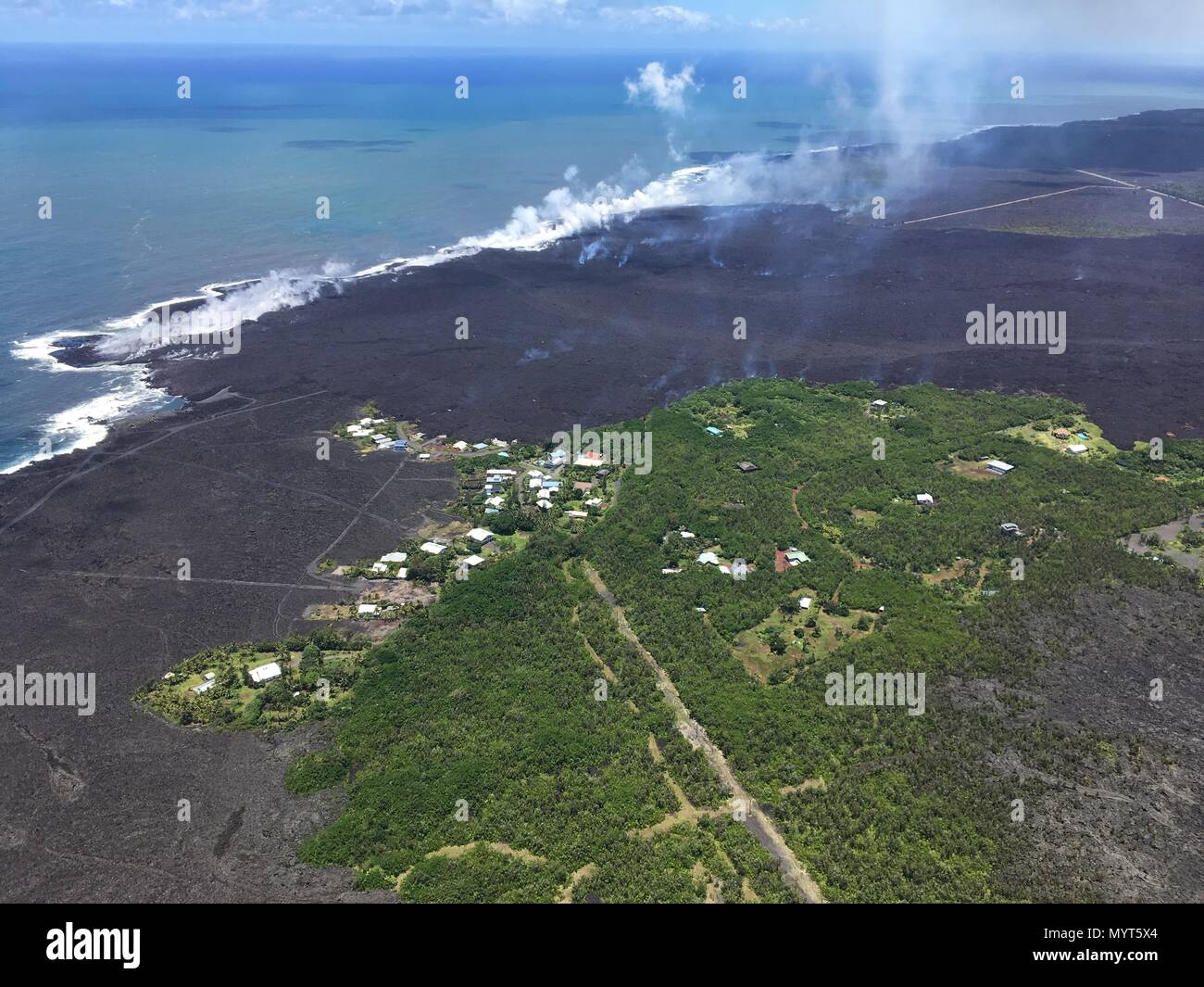 Hawaii, USA. 6th June, 2018. A view of the remains of Vacationland and Kapoho Bay after lava flows filled the bay and destroyed the forest and homes from the eruption of the Kilauea volcano June 6, 2018 in Hawaii. The recent eruption continues destroying homes, forcing evacuations and spewing lava and poison gas on the Big Island of Hawaii. Credit: Planetpix/Alamy Live News - Stock Image