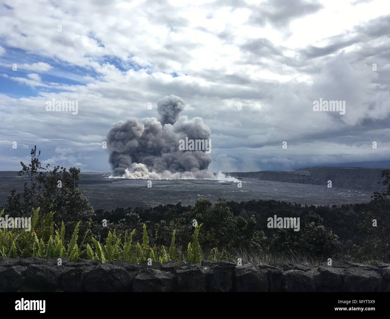 Hawaii, USA. 6th June, 2018. A massive ash cloud shoots into the air from the eruption of the Kilauea volcano June 6, 2018 in Hawaii. The recent eruption continues destroying homes, forcing evacuations and spewing lava and poison gas on the Big Island of Hawaii. Credit: Planetpix/Alamy Live News Stock Photo
