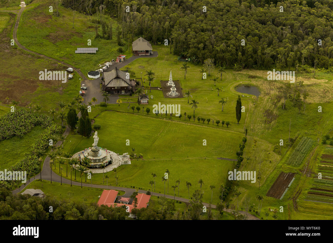 Pahoa, Hawaii, USA. 6th June, 2018. The grounds of a Buddhist temple outside Pahoa are untouched as the lower east rift zone eruption continues on Wednesday, June 6, 2018, in Pahoa, Hawaii. Photo by L.E. Baskow/LeftEyeImages Credit: L.E. Baskow/ZUMA Wire/Alamy Live News Stock Photo