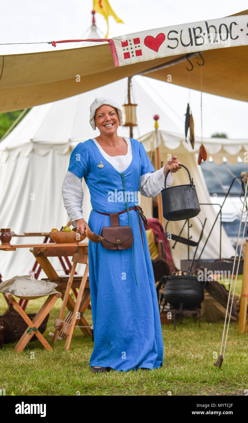 Ardingly Sussex UK 8th June 2018 - Sian Bailey from the Hartley Companie , a medieval reenactment group at the South of England Show in beautiful sunny weather held at the Ardingly Showground near Haywards Heath Sussex Credit: Simon Dack/Alamy Live News Stock Photo