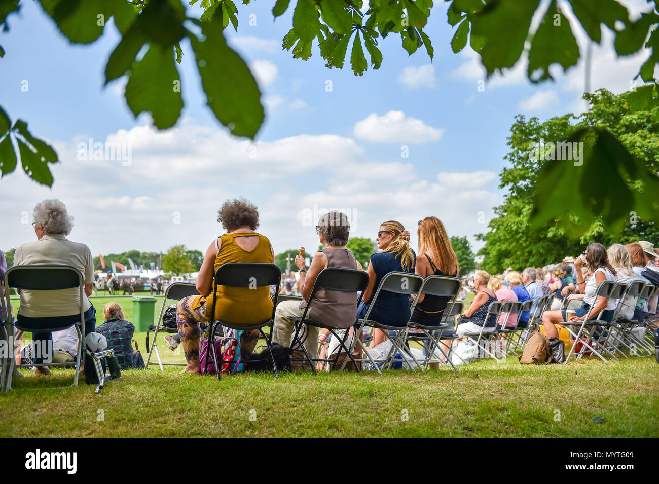 Ardingly Sussex UK 8th June 2018 - Crowds enjoy the sunshine at the South of England Show  at the Ardingly Showground near Haywards Heath Sussex Photograph by Simon Dack Credit: Simon Dack/Alamy Live News - Stock Image