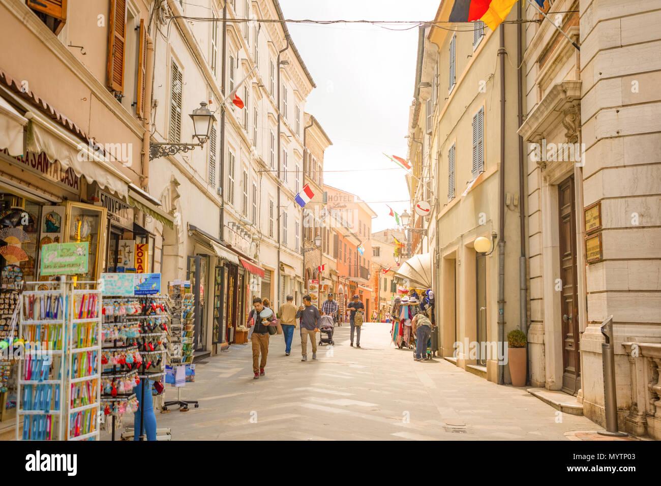 Loreto, Ancona, Italy - 8.05.2018: The central shopping street Corso Traiano Boccalini leads to Basilica of Santa Casa in Loreto - Stock Image