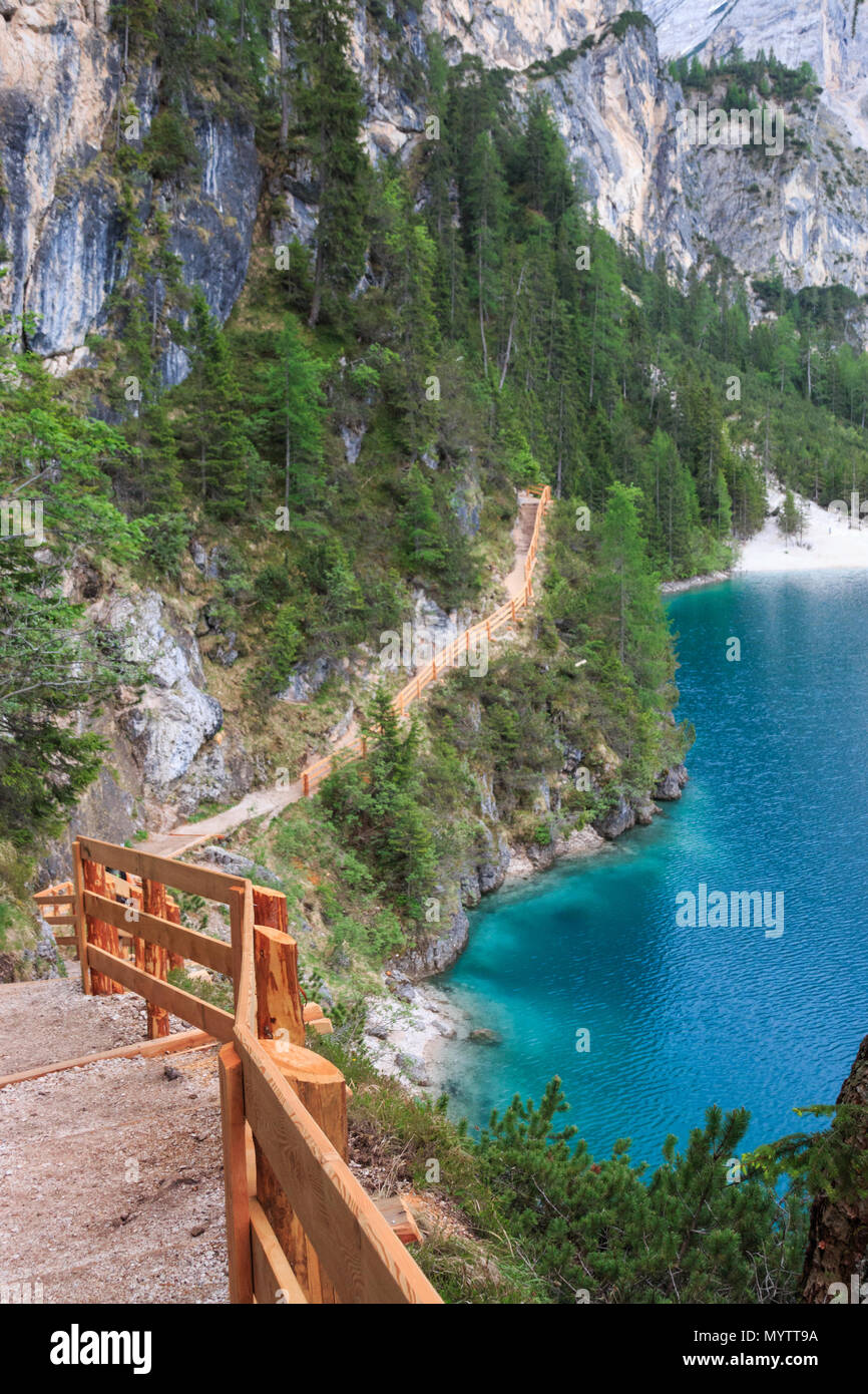 Visitors  can walk around Lake Braies (Pragser Wildsee, Lago di Braies) on a hiking trail that runs along lakeshore Stock Photo