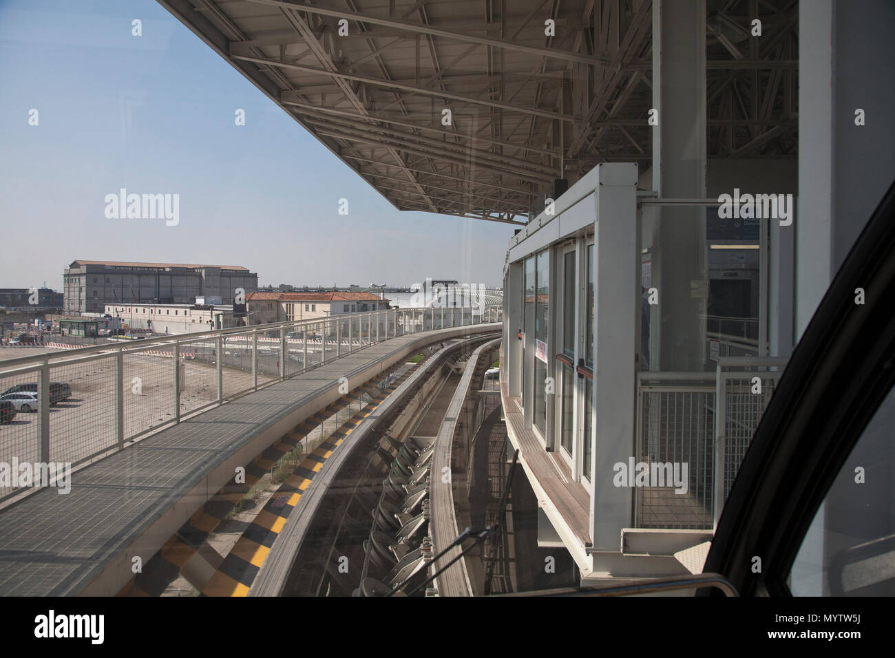 September 8, 2014- Venice, Italy: Tracks curve around a public transportation system that carries passengers around in Venice, Italy - Stock Image