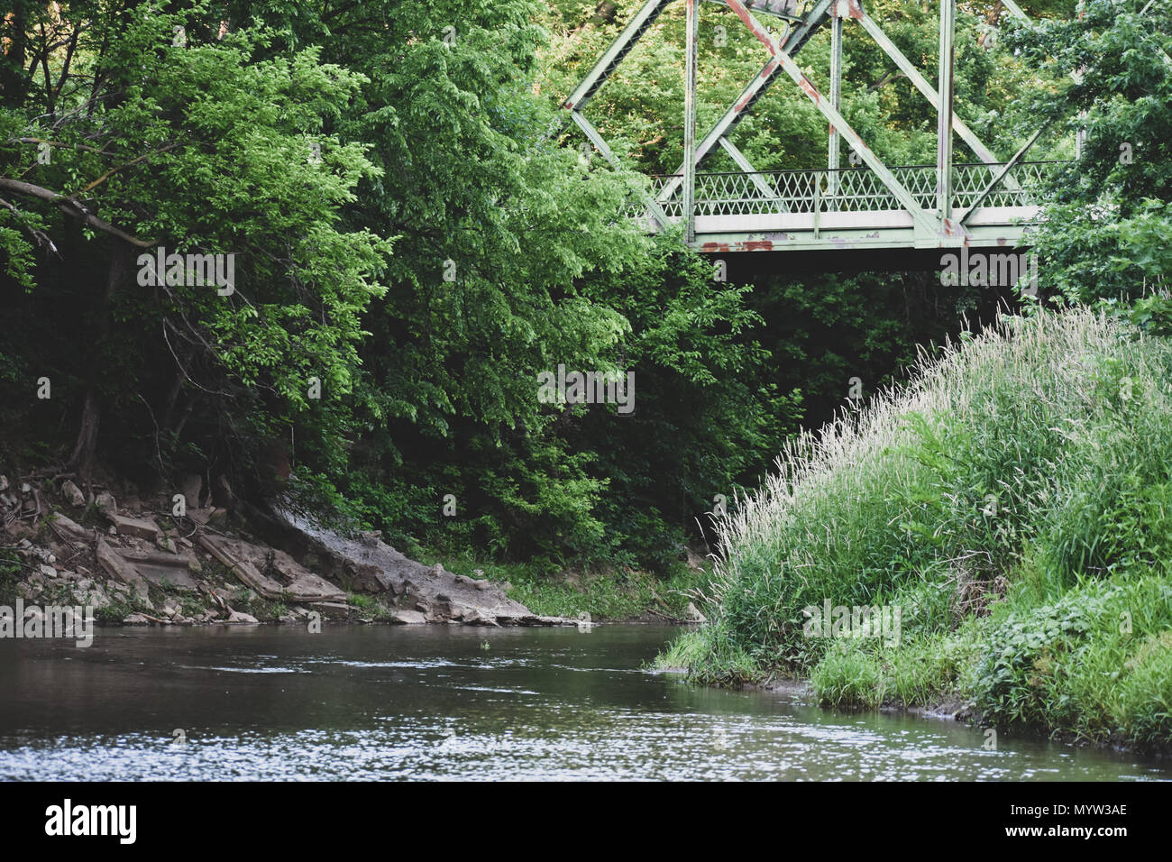 A beautiful shot of the Smokey Hill River, flowing calmly and steady under a bridge - Stock Image