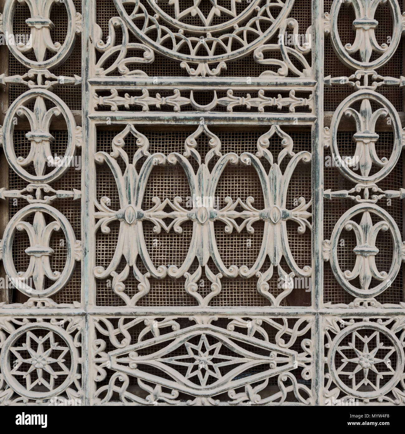 Grunge old window decorated with iron floral patterns, Mosque of Muhammad Ali, Cairo Citadel, Egypt - Stock Image