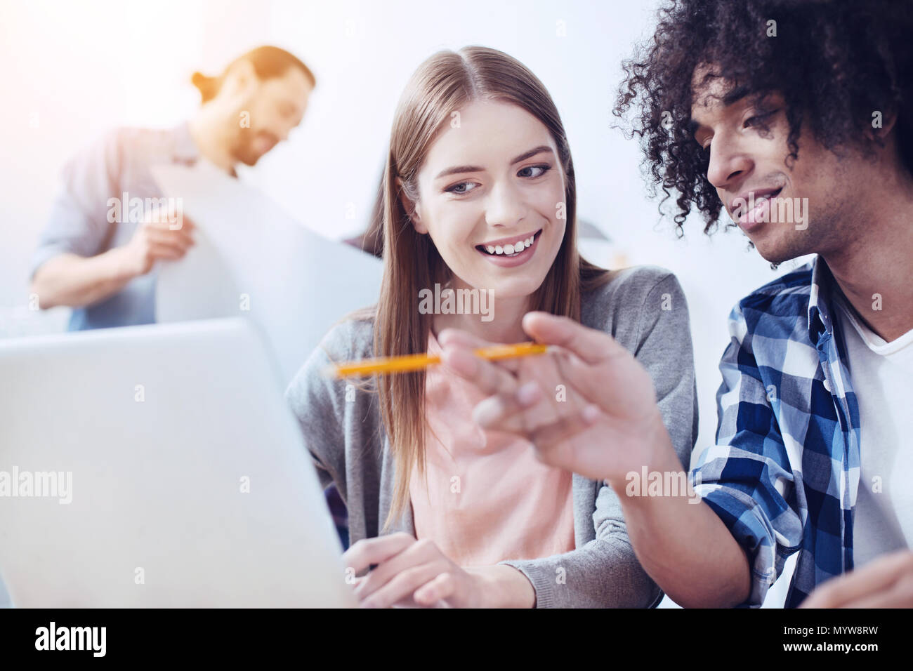 Attentive girl listening her group mate - Stock Image
