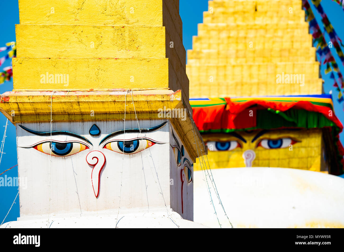 (Selective focus) Wisdom eye on a Swayambhunath Stupa also known as Monkey Temple. Swayambhunath Stupa is an ancient religious architecture atop a hil Stock Photo