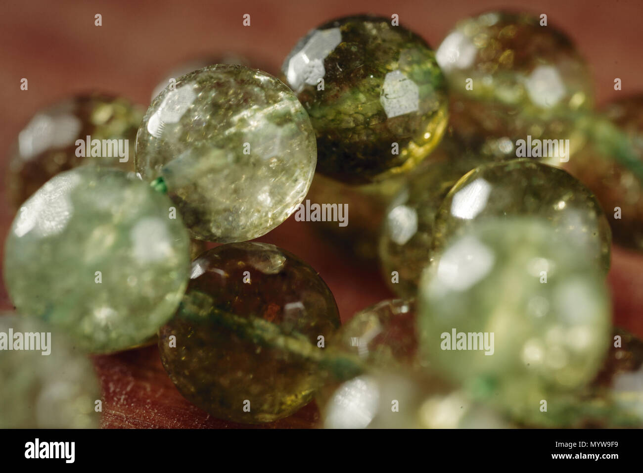 Natural green jade nephrite mineral stones beads. Stock Photo