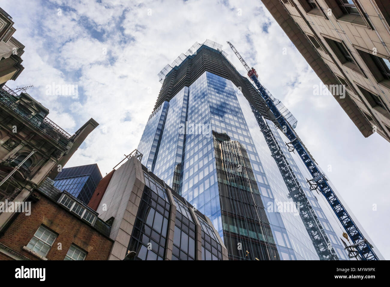 Partially completed skyscraper office tower 22 Bishopsgate in the heart of the financial district of the City of London EC2 reflecting Tower 42 Stock Photo