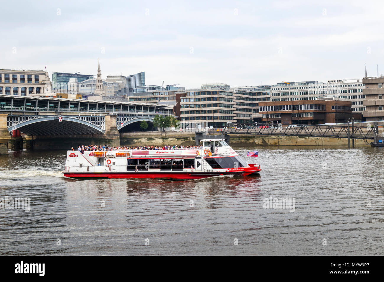 City Cruises riverboat 'Millennium of Peace' sailing past Blackfriars Bridge on a tourist sighseeing cruise tour on the River Thames, London - Stock Image