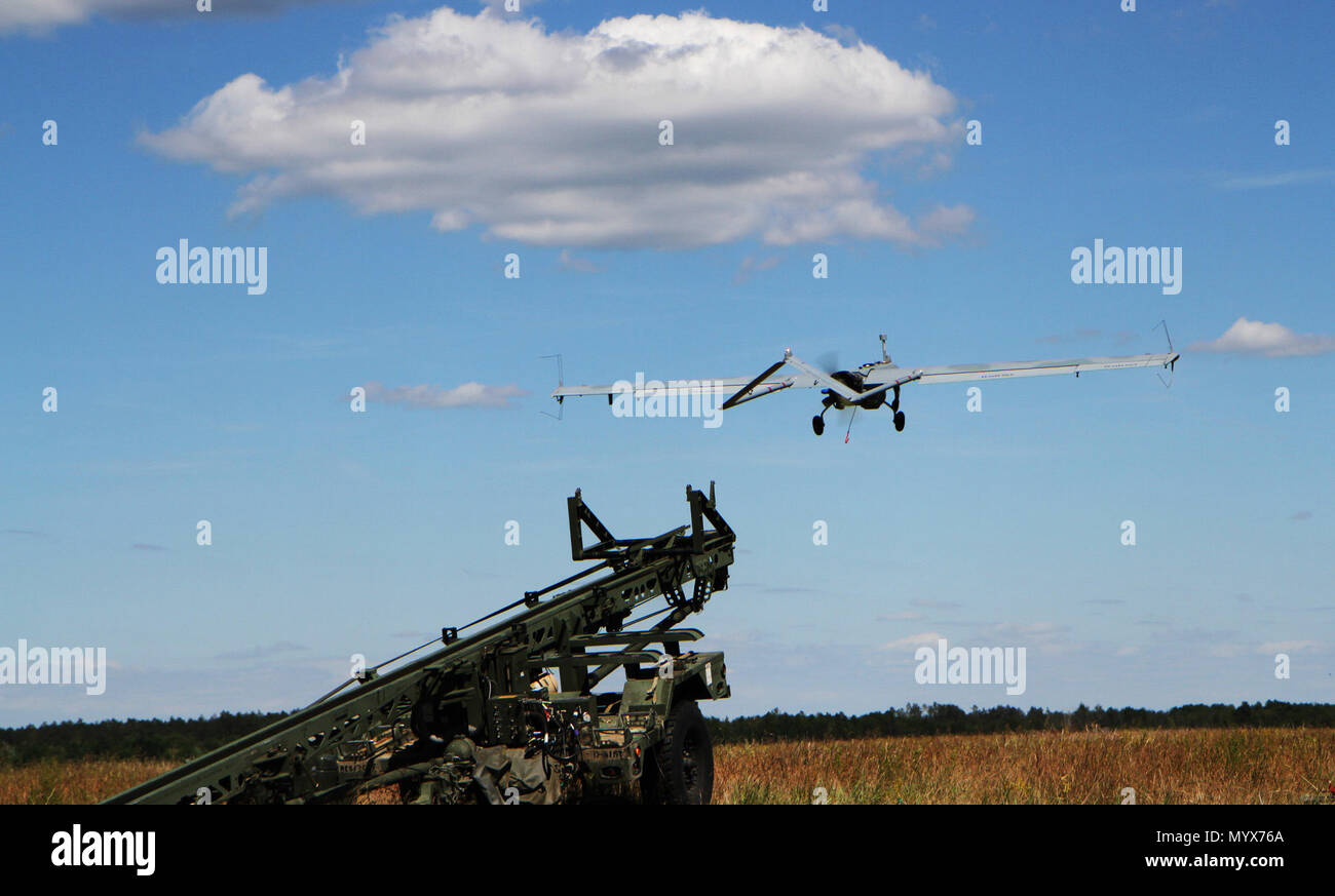 An Unmanned Aerial Vehicle AAI RQ-7 Shadow Drone takes flight as it is launched from a catapult during a training exercise as part of Saber Strike 18 at the Bemowo Piskie Training Area June 7, 2018. Saber Strike 18 is the eighth iteration of the long-standing U.S. Army Europe-led cooperative training exercise designed to enhance interoperability among allies and regional partners. (Michigan Army National Guard photo by Spc. Robert Douglas/ released.) - Stock Image