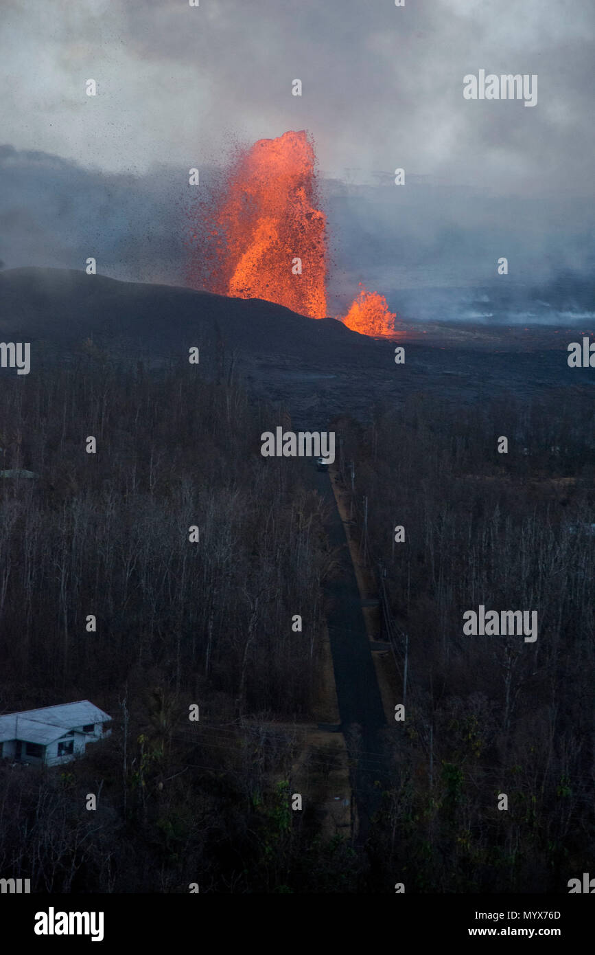 Leilani Estates, Hawaii, May 30, 2018 – Lava continues to fountain at Fissure 8, reaching heights of 130-210 feet. This activity is feeding a lava channel flowing east to the Kapoho Bay area as lava continues to enter the ocean around the Vacationland subdivision area. Volcanic gas emissions remain very high from the fissure eruptions. At the request of the state, FEMA staff are on the ground to support local officials with life-saving emergency protective measures, debris removal, and the repair, replacement, or restoration of disaster-damaged publicly-owned facilities. Photo: Grace Simoneau/ - Stock Image