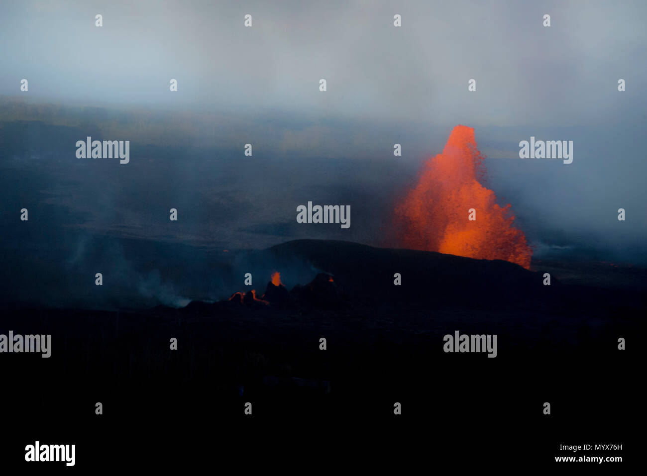 Leilani Estates, Hawaii, May 30, 2018 – Lava continues to fountain at Fissure 8, reaching heights of 130-210 feet. This activity is feeding a lava channel flowing east to the Kapoho Bay area and lava continues to enter the ocean around the Vacationland subdivision area. Volcanic gas emissions remain very high from the fissure eruptions. At the request of the state, FEMA staff are on the ground to support local officials with life-saving emergency protective measures, debris removal, and the repair, replacement, or restoration of disaster-damaged publicly-owned facilities. Photo: Grace Simoneau - Stock Image