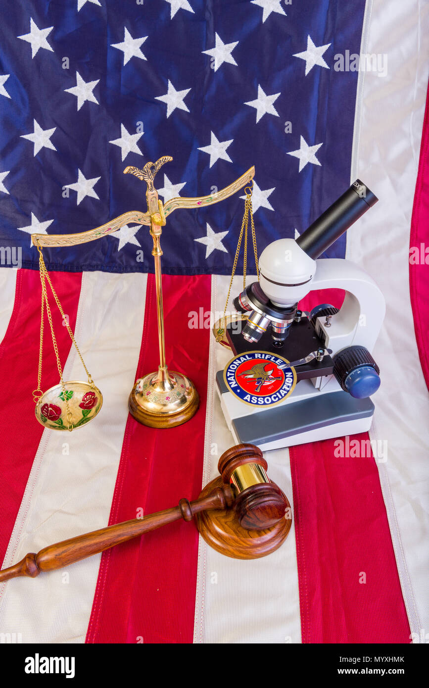Winneconne - 11 May 2018: The NRA under a microscope showing the scrutiny the second ammendment is under with the American flag - Stock Image