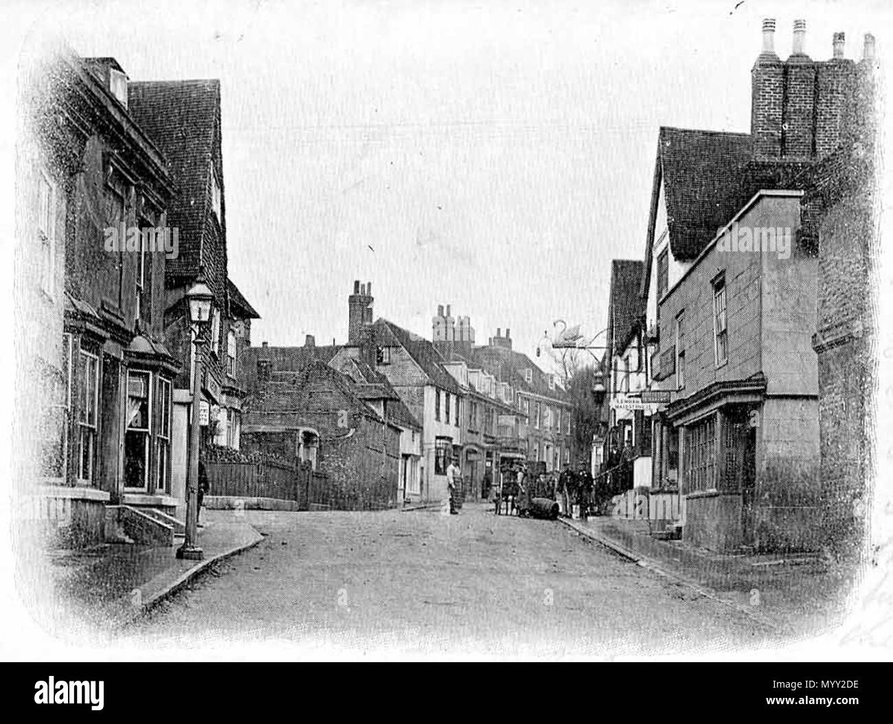 . English: Charing High Street, Charing, Kent, c1905. View taken looking north up the High Street. From a black and white postcard c1905, no printer's or photographer's name. It looks similar to today, as not much change has occurred in the last 100 years in the village.  . 19 November 2005 (original upload date). The original uploader was Humansdorpie at English Wikipedia 48 High Street, Charing, Kent, c1905 - Stock Image