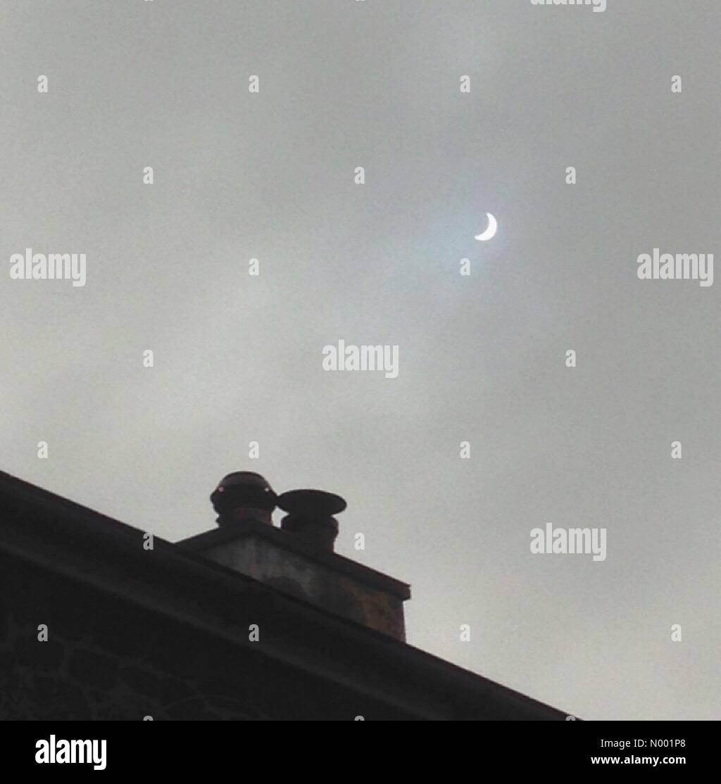 Exeter, Devon, UK. 20th Mar, 2015. Eclipse over chimneys in Doddiscombsleigh, Devon Credit:  nidpor/StockimoNews/Alamy - Stock Image