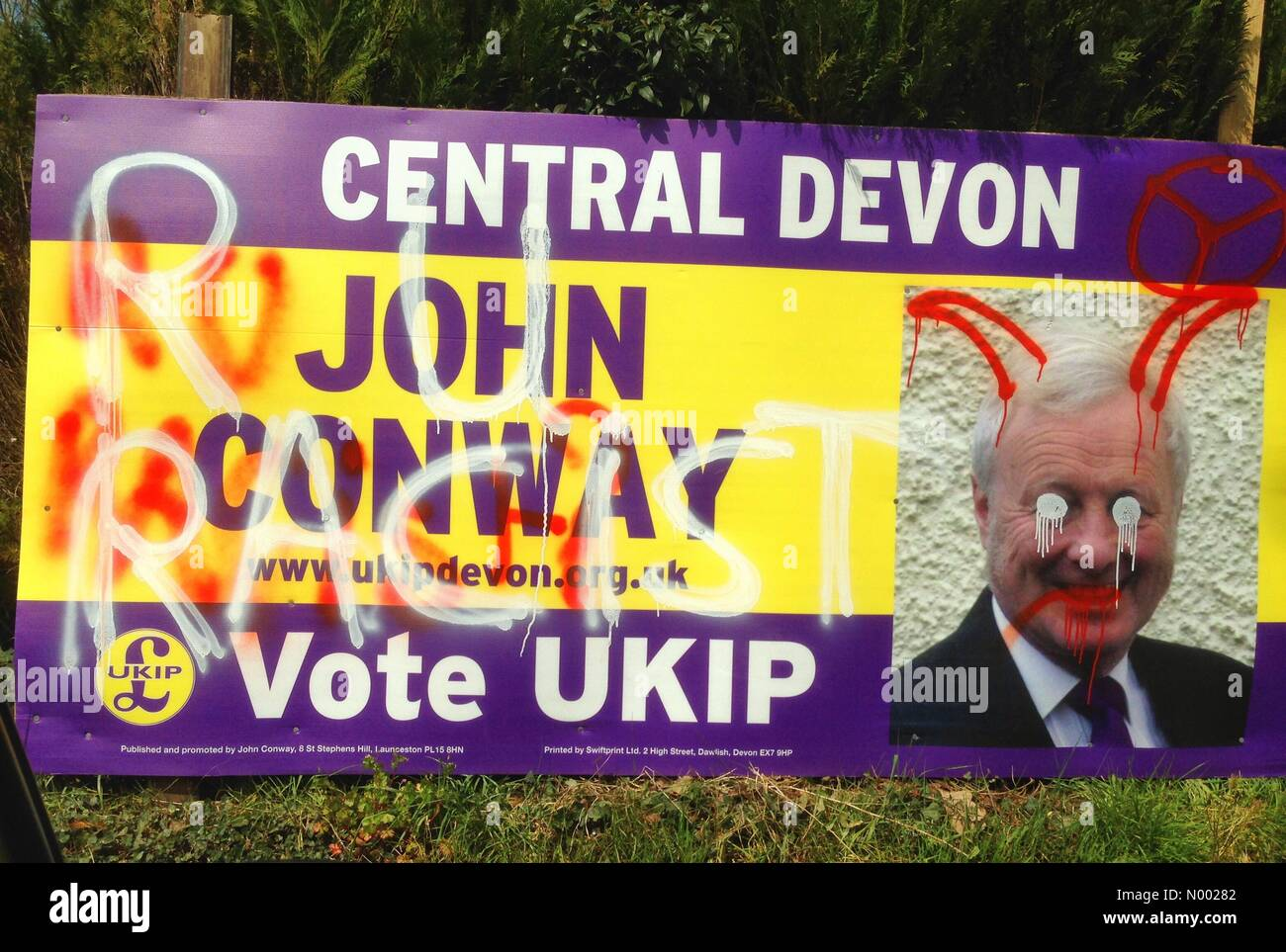 Defaced UKIP election poster in Christow, Devon - Stock Image