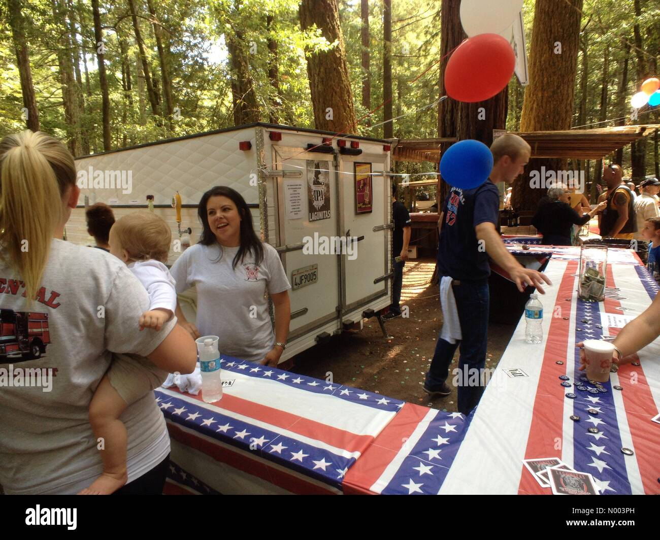 California, USA. 19th July, 2015. Volunteers sell beer at the Occidental Volunteer Fire Department annual BBQ. Credit: - Stock Image
