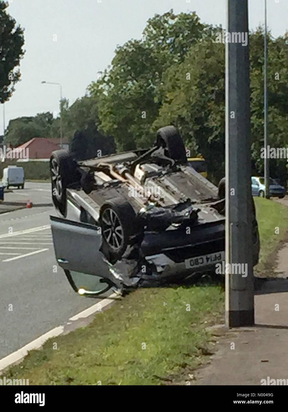 Preston, UK. 11th September, 2015. High speed crash resulting in overturned vehicle on A59 Liverpool Road near Brook - Stock Image