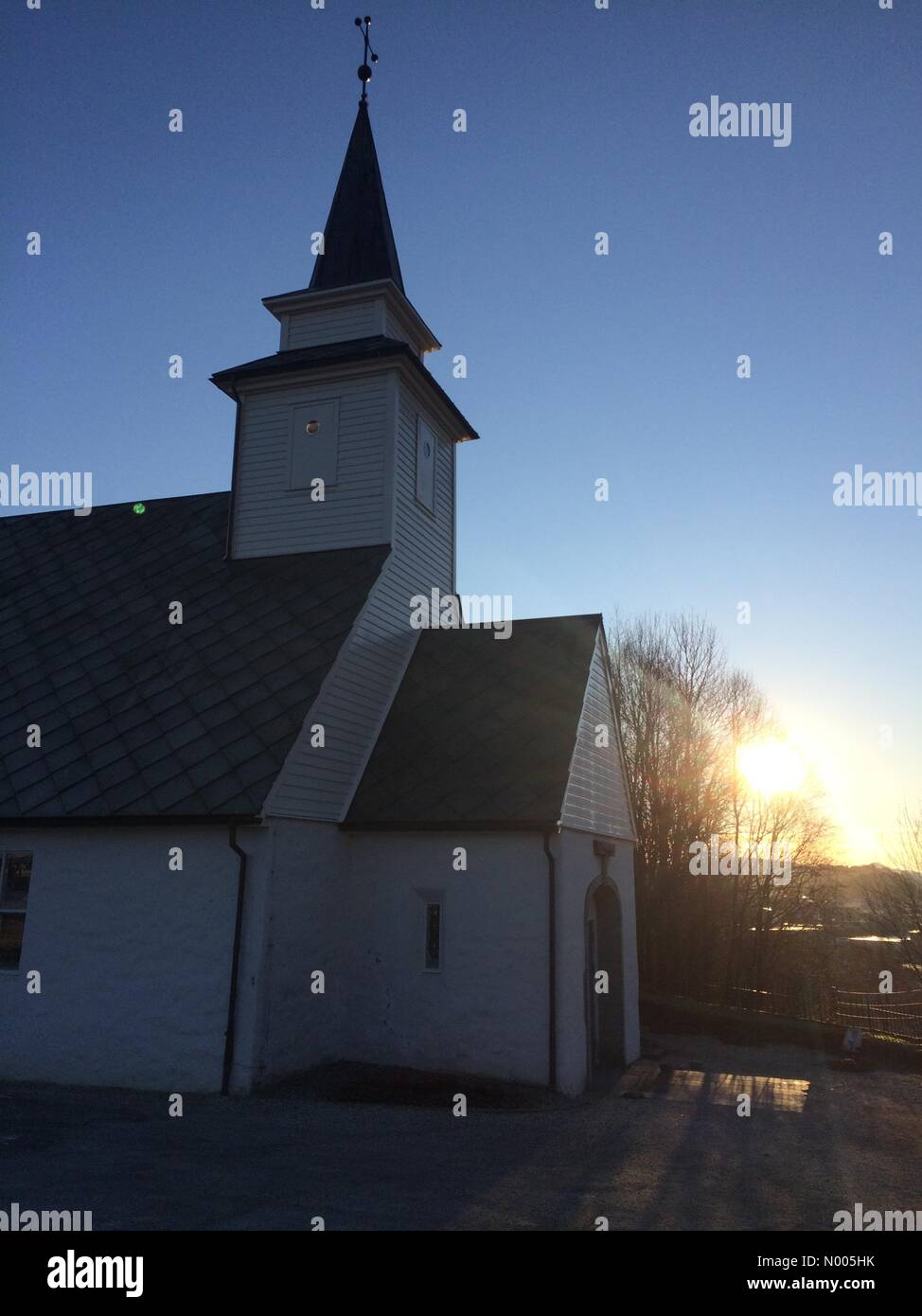 EUweather: Beautiful low sunlight streaking over the old church in Åsane this afternoon, Åsane, Bergen, - Stock Image