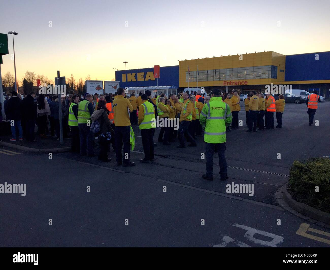 IKEA evacuated. Staff stand outside IKEA, Birmingham after the store was evacuated following a strong smell of burning. - Stock Image
