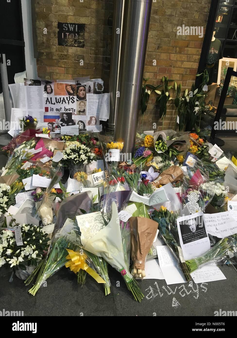 Flowers for Alan Rickman at Kings Cross - Stock Image