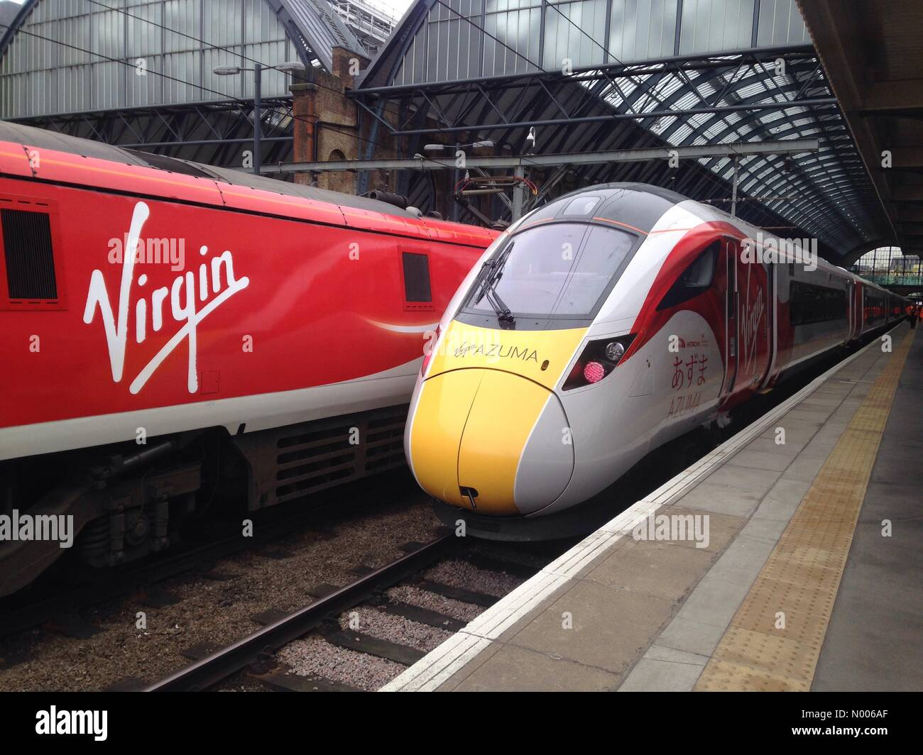 London, UK. 18th March, 2016. New IEP Virgin Train 800101 in Virgin colours at London Kings Cross. Due into service Stock Photo