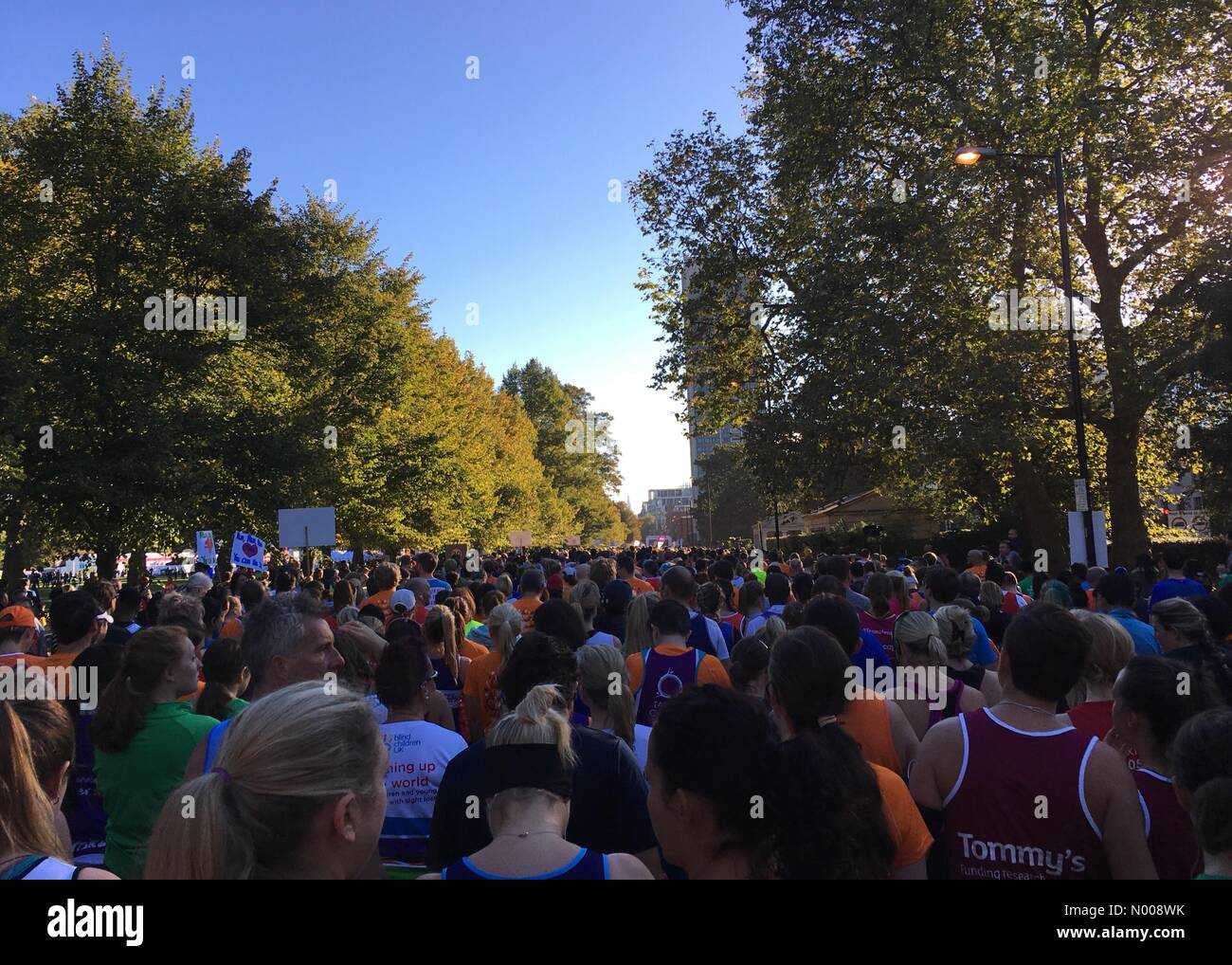 Some of the 16,000 people alongside Hyde park London at the start line for the Royal Parks half marathon Stock Photo