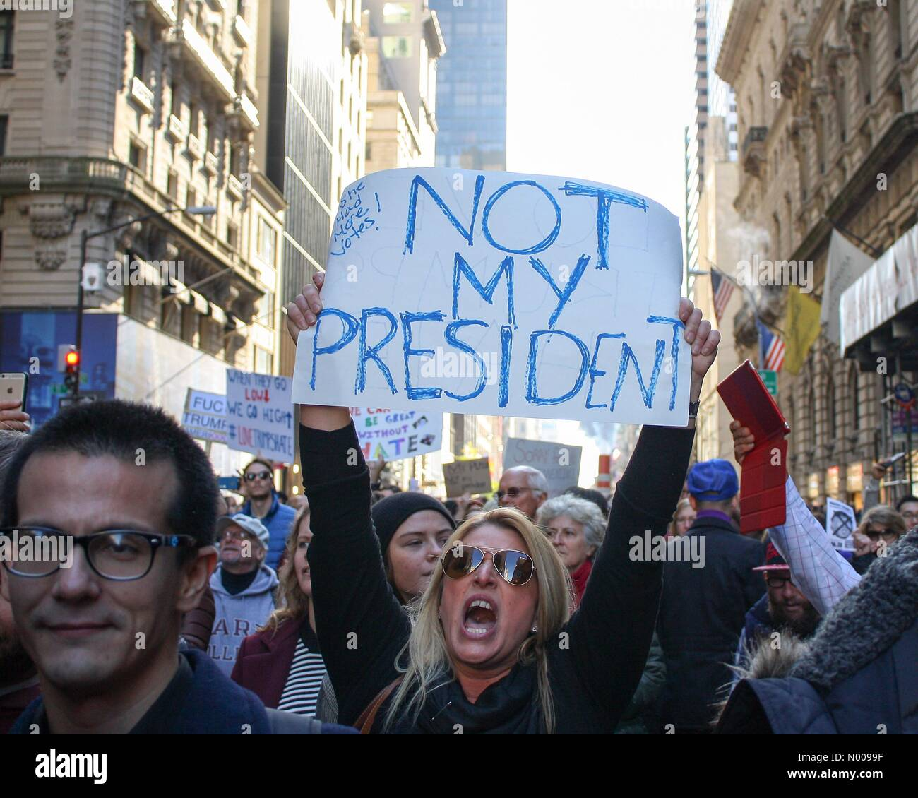 New York, New York, USA. 12th Nov, 2016. Woman holdinhsignshouts at NYC protest against Donald Trump Credit:  BumbyPix Stock Photo
