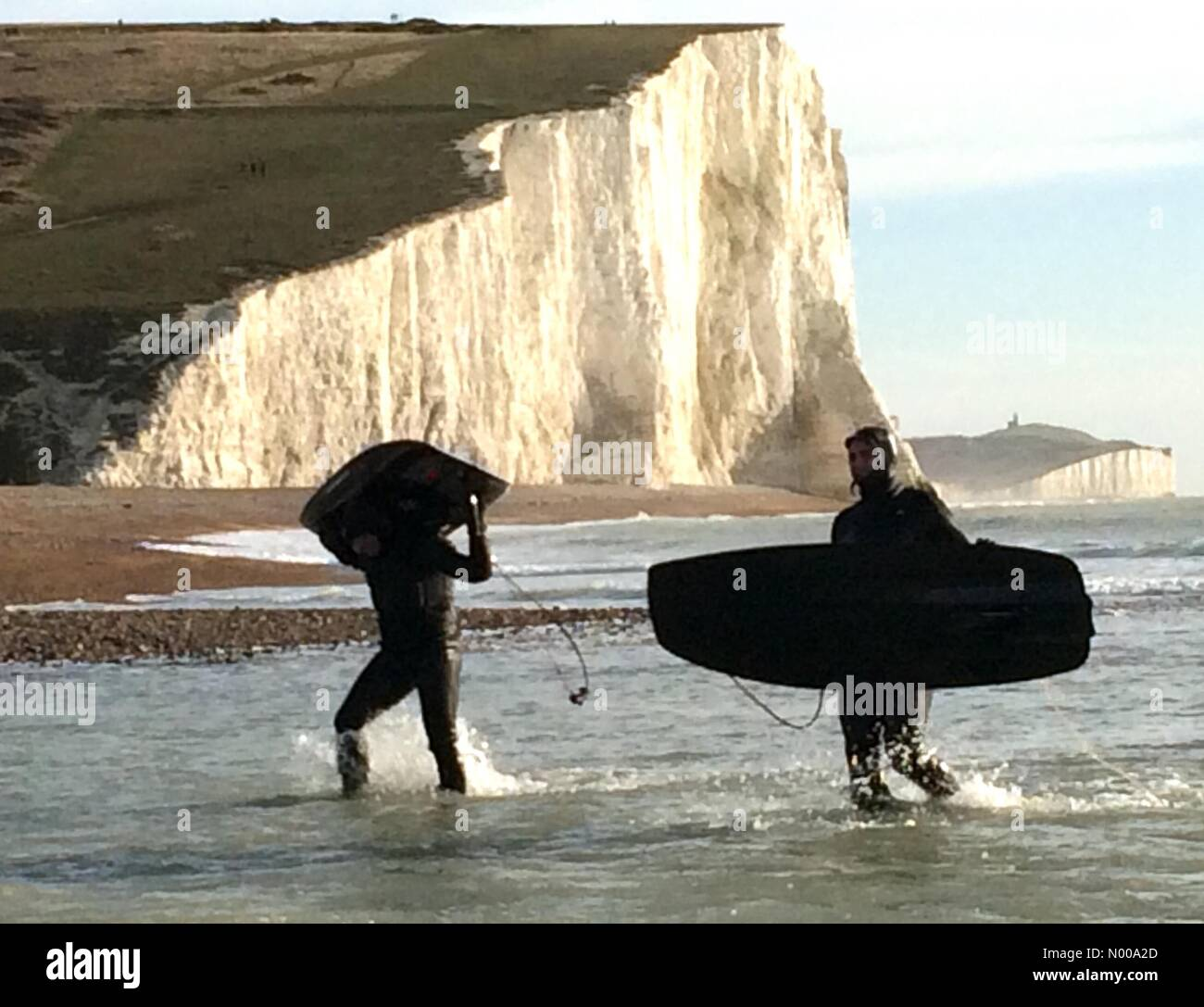 Cuckmere, East Sussex. 26th December 2016. Jet surfers leave the sea on a sunny Boxing Day at the Sussex Coast. - Stock Image