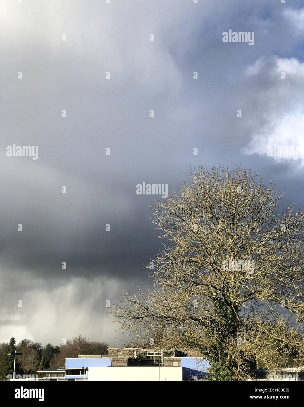 Godalming, UK. 27th Feb, 2017. UK Weather: Storm clouds over Godalming. Tuesley Ln, Godalming. 27th Feb 2017. Unstable - Stock Image