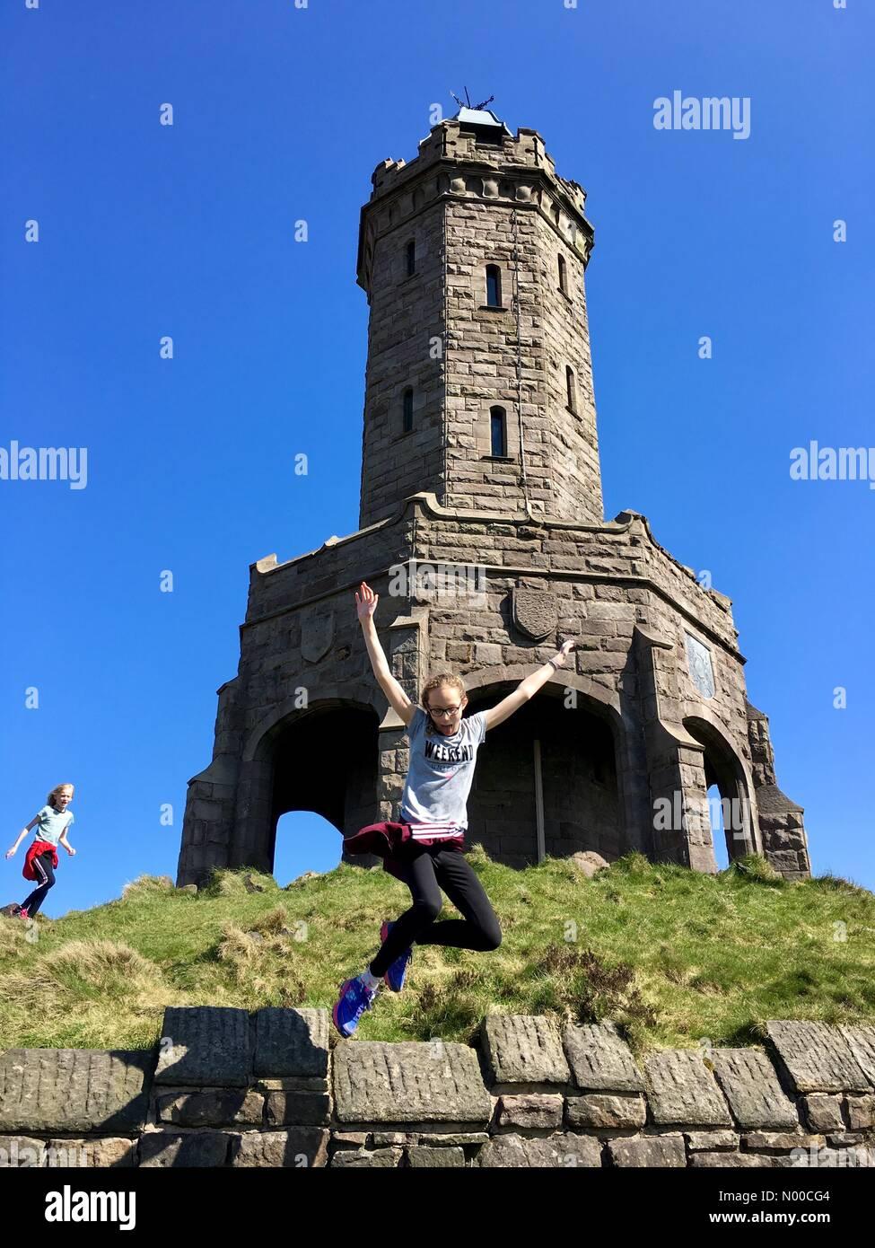 Uk Weather Day In Blackburn Lancashire Two Girls Having Fun In The Sun At Darwen Jubilee Tower On The Moors Above Blackburn