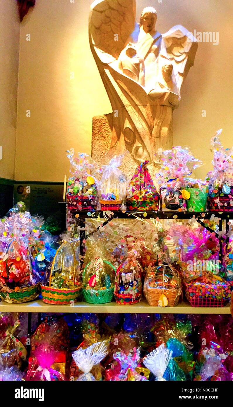Spectacular Classic Archangel statue guards hundreds of Easter Baskets at  the Mother Church  of the Paulist Order Stock Photo