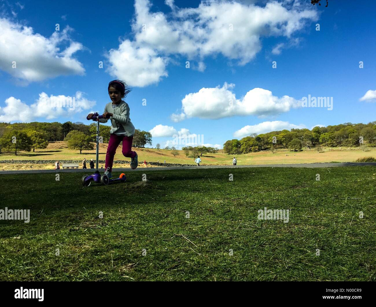 15th April 2017, 1500 hrs. Leicester, UK. Children playing outdoors under a blue sky despite forecasts of a cloudy - Stock Image