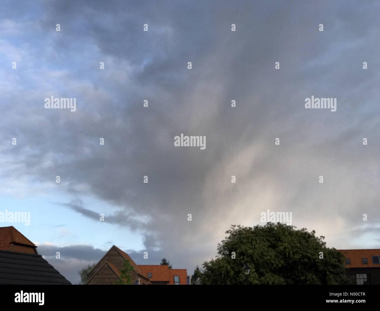 Tuesley Ln, Godalming, UK. 17th Apr, 2017. UK Weather: Stormy sunrise over Godalming. Tuesley Farm, Godalming. 17th - Stock Image