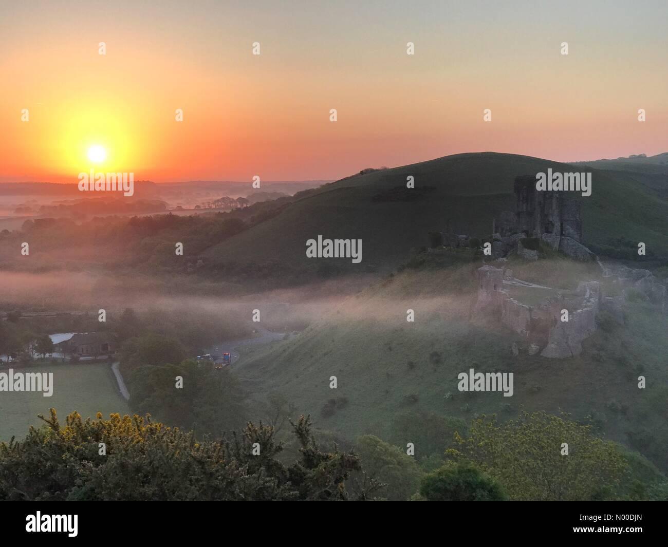Wareham, UK. 10th May, 2017. UK Weather: Sunrise over Corfe Castle. Wareham, Dorset. 10th May 2017. High pressure - Stock Image